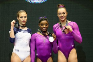 Winners pose with their medals for the floor routine during the women's apparatus final at the World Gymnastics Championships at the Hydro arena in Glasgow