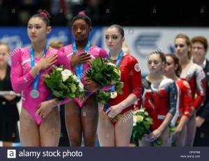 epa03896574-l-r-silver-medalist-kyla-ross-of-the-us-gold-winner-simone-DFN79M