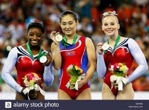 epa04441449-l-r-silver-medalist-simone-biles-of-the-usa-gold-medalist-E8T8X6