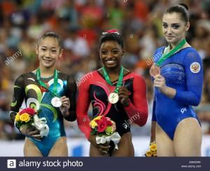 epa04442916-gold-medal-winner-simone-biles-c-of-the-usa-on-the-podium-E8WDRK