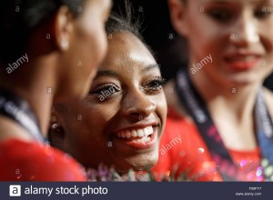 epa04999170-simone-biles-reacts-as-usa-win-gold-at-the-womens-team-F59FY7
