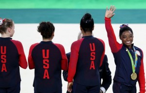 FEB9-USAs-Simone-Biles-poses-with-her-gold-medal