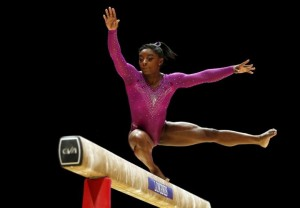Simone Biles of the U.S. performs during her beam routine in the women's apparatus final at the World Gymnastics Championships at the Hydro arena in Glasgow